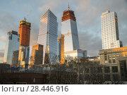 Купить «10 Hudson Yards, center left, 30 Hudson Yards, center right, and other Hudson Yards development in New York on Wednesday, January 24, 2018. The Eugene apartment building is on the right.», фото № 28446916, снято 24 января 2018 г. (c) age Fotostock / Фотобанк Лори