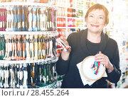 Купить «Woman buying embroidery accessories», фото № 28455264, снято 10 мая 2017 г. (c) Яков Филимонов / Фотобанк Лори