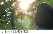 Купить «Woman blow bubbles at sunset», видеоролик № 28459828, снято 12 мая 2018 г. (c) Илья Шаматура / Фотобанк Лори
