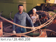 Купить «Two farmers close to huge tractor», фото № 28460208, снято 25 мая 2018 г. (c) Яков Филимонов / Фотобанк Лори
