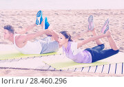 Купить «Happy man and woman training on beach by sea», фото № 28460296, снято 16 октября 2019 г. (c) Яков Филимонов / Фотобанк Лори