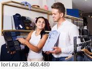 Купить «Couple purchasing shirt and tie», фото № 28460480, снято 24 октября 2016 г. (c) Яков Филимонов / Фотобанк Лори