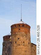 Купить «Башня Кijlin крупным планом мартовским вечером. Крепость Олавинлинна в Савонлинне. Финляндия», фото № 28460528, снято 3 марта 2018 г. (c) Виктор Карасев / Фотобанк Лори