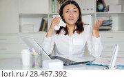 Купить «Worried female doctor working at laptop with papers in her office», видеоролик № 28467392, снято 21 мая 2018 г. (c) Яков Филимонов / Фотобанк Лори