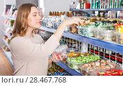 Купить «girl customer choosing variety candies», фото № 28467768, снято 11 апреля 2018 г. (c) Яков Филимонов / Фотобанк Лори