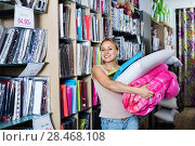 Купить «Young woman buying bedding goods in textile store», фото № 28468108, снято 16 октября 2018 г. (c) Яков Филимонов / Фотобанк Лори