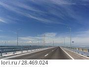 Купить «Асфальтовое полотно Крымского моста над косой Тузла. Май 2018 года», фото № 28469024, снято 19 мая 2018 г. (c) Наталья Гармашева / Фотобанк Лори
