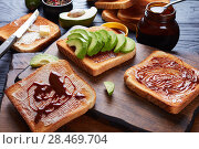 Купить «salty toasts with butter, avocado, yeast spread», фото № 28469704, снято 13 мая 2018 г. (c) Oksana Zh / Фотобанк Лори