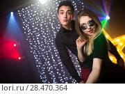 Купить «couple of dancing people at a disco», фото № 28470364, снято 10 марта 2018 г. (c) Типляшина Евгения / Фотобанк Лори