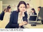 Купить «Portrait of unhappy girl in modern open plan office on background with coworkers», фото № 28470652, снято 21 апреля 2018 г. (c) Яков Филимонов / Фотобанк Лори
