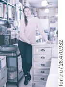 Купить «Female choosing commode in store», фото № 28470932, снято 15 ноября 2017 г. (c) Яков Филимонов / Фотобанк Лори