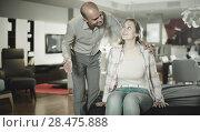 Купить «couple testing new bed in modern home furnishings store», фото № 28475888, снято 16 мая 2017 г. (c) Яков Филимонов / Фотобанк Лори