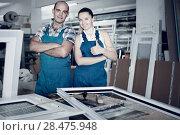 Купить «Man and woman in blue overalls standing with hands crossed at workplace», фото № 28475948, снято 19 июля 2017 г. (c) Яков Филимонов / Фотобанк Лори