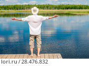 Купить «free happy man enjoys the beautiful nature near the lake, view from the back», фото № 28476832, снято 14 июня 2016 г. (c) Константин Лабунский / Фотобанк Лори