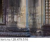 Купить «Statues carved on wall of temple, Krong Siem Reap, Siem Reap, Cambodia», фото № 28479516, снято 26 марта 2019 г. (c) Ingram Publishing / Фотобанк Лори