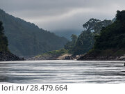 Scenic view of river flowing through mountains, River Mekong, Oudomxay Province, Laos. Стоковое фото, фотограф Keith Levit / Ingram Publishing / Фотобанк Лори