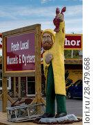 Купить «Sculpture and sign at fishing harbor, Pleasant Bay, Cabot Trail, Cape Breton Island, Nova Scotia, Canada», фото № 28479668, снято 12 июня 2016 г. (c) Ingram Publishing / Фотобанк Лори
