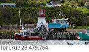 Fishing trawlers moored at dock, Pleasant Bay, Cape Breton Island, Nova Scotia, Canada (2016 год). Стоковое фото, фотограф Keith Levit / Ingram Publishing / Фотобанк Лори