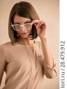 Купить «Elegant woman in glasses», фото № 28479912, снято 18 января 2014 г. (c) Ingram Publishing / Фотобанк Лори