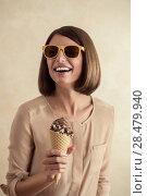 Купить «Ice cream woman singing in cone like in microphone happy, joyful and cheerful. Cute young female model eating ice cream cone», фото № 28479940, снято 18 января 2014 г. (c) Ingram Publishing / Фотобанк Лори