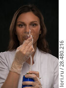 Купить «Female doctor holding can with oxygen and breathing through the mask», фото № 28480216, снято 16 мая 2014 г. (c) Ingram Publishing / Фотобанк Лори