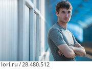 Купить «Athlete posing outdoors in city. Standing with hands folded», фото № 28480512, снято 22 июня 2014 г. (c) Ingram Publishing / Фотобанк Лори