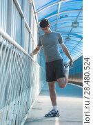 Купить «Attractive fit young man stretching before exercise, sunrise early morning backlit. Shallow depth of field», фото № 28480524, снято 22 июня 2014 г. (c) Ingram Publishing / Фотобанк Лори