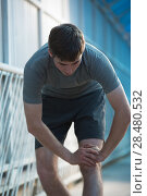 Купить «Attractive fit young man stretching before exercise, sunrise early morning backlit. Shallow depth of field», фото № 28480532, снято 22 июня 2014 г. (c) Ingram Publishing / Фотобанк Лори