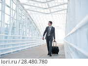 Man at the Airport with Suitcase. Стоковое фото, фотограф Kirill Kedrinskiy / Ingram Publishing / Фотобанк Лори