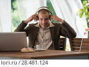 Купить «Business man resting at cafe and listening music using vintage headphones», фото № 28481124, снято 20 июля 2014 г. (c) Ingram Publishing / Фотобанк Лори