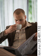 Купить «Pensive businessman reading a newspaper in cafe», фото № 28481132, снято 20 июля 2014 г. (c) Ingram Publishing / Фотобанк Лори