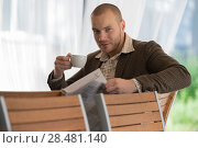 Купить «Pensive businessman reading a newspaper in cafe», фото № 28481140, снято 20 июля 2014 г. (c) Ingram Publishing / Фотобанк Лори