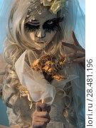 Купить «Halloween witch. Beautiful bride woman wearing santa muerte mask and wedding dress holding dead bouquet of roses», фото № 28481196, снято 21 сентября 2014 г. (c) Ingram Publishing / Фотобанк Лори