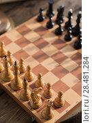 Купить «Chess pieces on board at home», фото № 28481284, снято 10 октября 2014 г. (c) Ingram Publishing / Фотобанк Лори