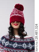 Купить «Portrait of beautiful brunette girl with knitted beanie on her face. Christmas mood», фото № 28481324, снято 15 октября 2014 г. (c) Ingram Publishing / Фотобанк Лори