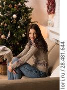 Купить «Beautiful woman wearing winter outfit drinking tea with candy at home near Christmas tree», фото № 28481644, снято 12 ноября 2014 г. (c) Ingram Publishing / Фотобанк Лори