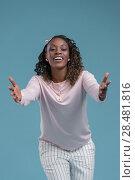 Купить «Portrait of cute african woman posing - welcoming gesture», фото № 28481816, снято 19 ноября 2014 г. (c) Ingram Publishing / Фотобанк Лори