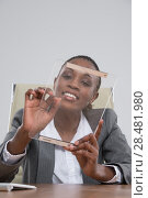 Купить «Beautiful african modern businesswoman holding tablet computer at her workplace at office», фото № 28481980, снято 19 ноября 2014 г. (c) Ingram Publishing / Фотобанк Лори