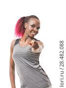 Купить «Portrait of attractive smile laugh african teenage girl pointing her finger isolated over white background», фото № 28482088, снято 19 ноября 2014 г. (c) Ingram Publishing / Фотобанк Лори