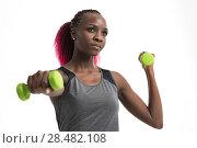 Купить «Portrait of pretty sporty girl holding weights», фото № 28482108, снято 19 ноября 2014 г. (c) Ingram Publishing / Фотобанк Лори