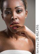 Купить «Portrait of a sensual young African woman holding finger in mouth», фото № 28482416, снято 20 ноября 2014 г. (c) Ingram Publishing / Фотобанк Лори