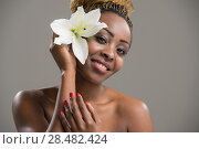 Купить «Portrait of a sensual young African woman with lily flower in hair», фото № 28482424, снято 20 ноября 2014 г. (c) Ingram Publishing / Фотобанк Лори