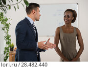 Business people of different human races chatting at office together. Стоковое фото, фотограф Kirill Kedrinskiy / Ingram Publishing / Фотобанк Лори