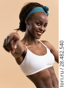 Купить «Portrait of young african athletic girl pointing at camera», фото № 28482540, снято 20 ноября 2014 г. (c) Ingram Publishing / Фотобанк Лори