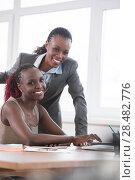 Купить «Young african business women in office working together on laptop», фото № 28482776, снято 1 декабря 2014 г. (c) Ingram Publishing / Фотобанк Лори