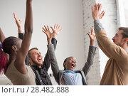 Купить «Business team celebrating a good job in the office», фото № 28482888, снято 1 декабря 2014 г. (c) Ingram Publishing / Фотобанк Лори