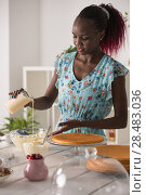 Купить «Young Woman Cooking at home. Healthy Food. Dessert Concept. Healthy Lifestyle. Cooking At Home. Prepare Food», фото № 28483036, снято 1 декабря 2014 г. (c) Ingram Publishing / Фотобанк Лори