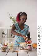 Купить «Young Woman Cooking at home. Healthy Food. Dessert Concept. Healthy Lifestyle. Cooking At Home. Prepare Food», фото № 28483040, снято 1 декабря 2014 г. (c) Ingram Publishing / Фотобанк Лори