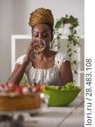 Купить «Closeup Of Beautiful African American Woman Eating Healthy Food and Drinking Wine At Home», фото № 28483108, снято 1 декабря 2014 г. (c) Ingram Publishing / Фотобанк Лори