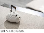 Купить «Asian tea pot at comfortable lounge», фото № 28483616, снято 19 декабря 2012 г. (c) Ingram Publishing / Фотобанк Лори